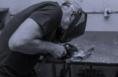 man welding and fabricating for mobility products and scooters